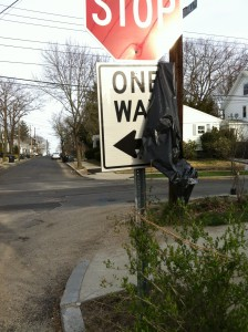 One Way sign covered with a bag